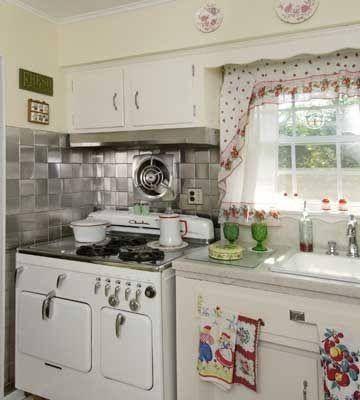 kitchen with tin tile backsplash and retro linens interiors rh pinterest com