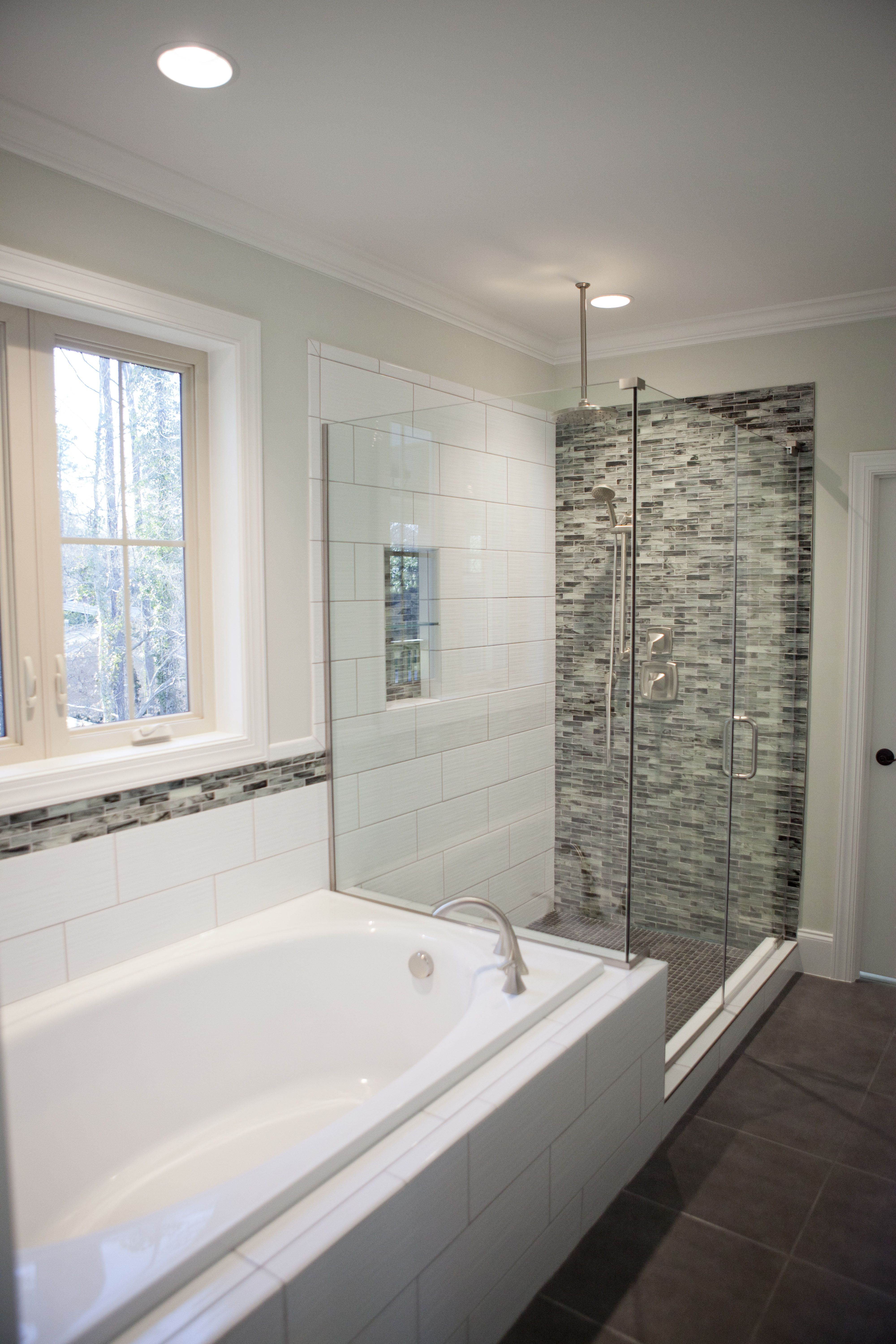 Custom tile accent wall in corner shower