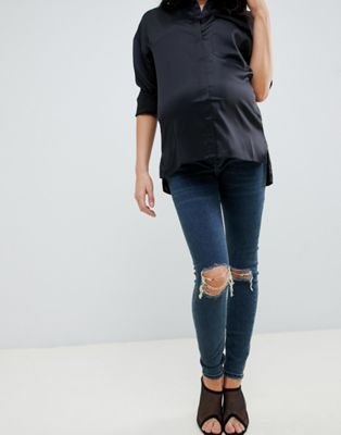 f8ad1ebfe1942 ASOS DESIGN Maternity Ridley high waist skinny jeans in london blue wash  with ripped knees and