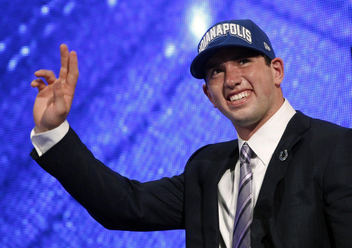 Andrew Luck from Stanford University, waves on stage after
