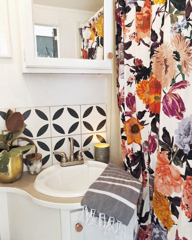 Arrows and bow renovated rv trailer inspiration bathroom tiles