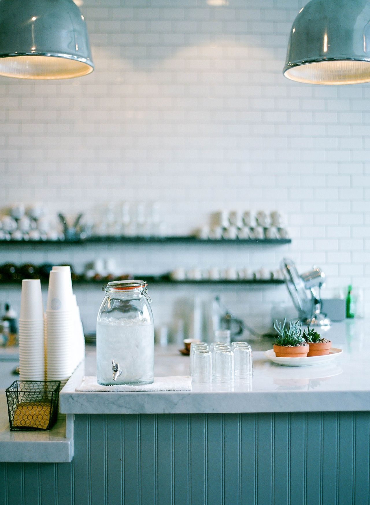 san francisco's beacon coffee and pantry uses seafoam blue shelves