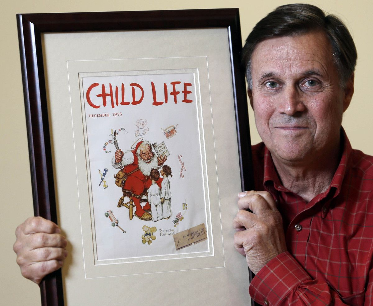 "Don Trachte of Bennington, Vt., poses with a1953 Child Life magazine cover illustration ""Santa's Helpers"" by Norman Rockwell for which he modeled, at the Bennington Museum on Friday, Sept. 28, 2012, in Bennington, Vt. Trachte is the child on the left."