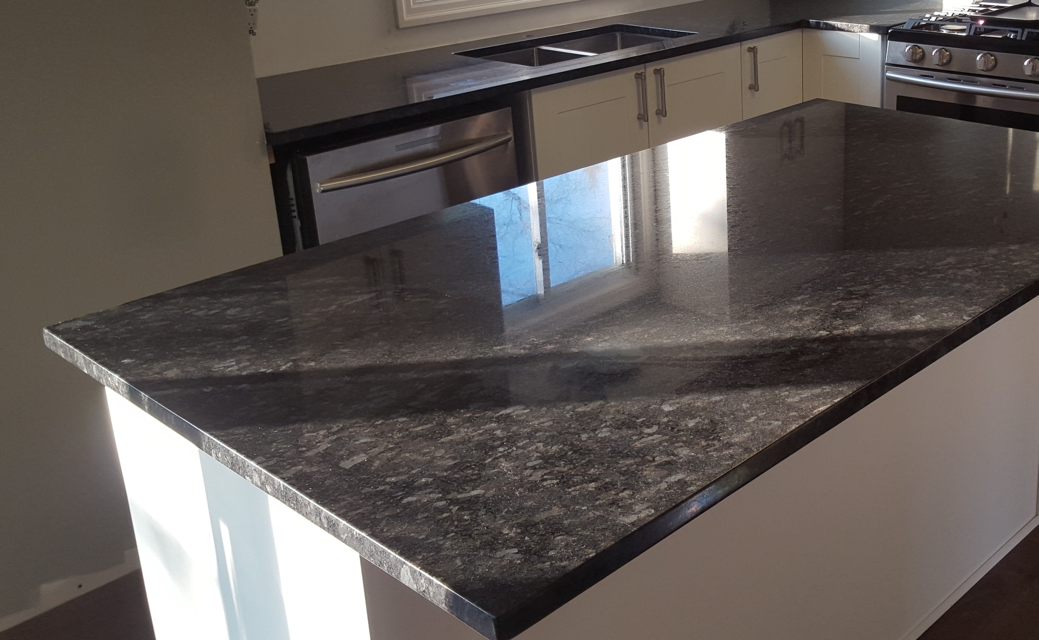 Cool Steel Grey Granite Beautifully Compliments Your White Cabinetry Cabinets And Countertops How To Install Countertops White Cabinetry