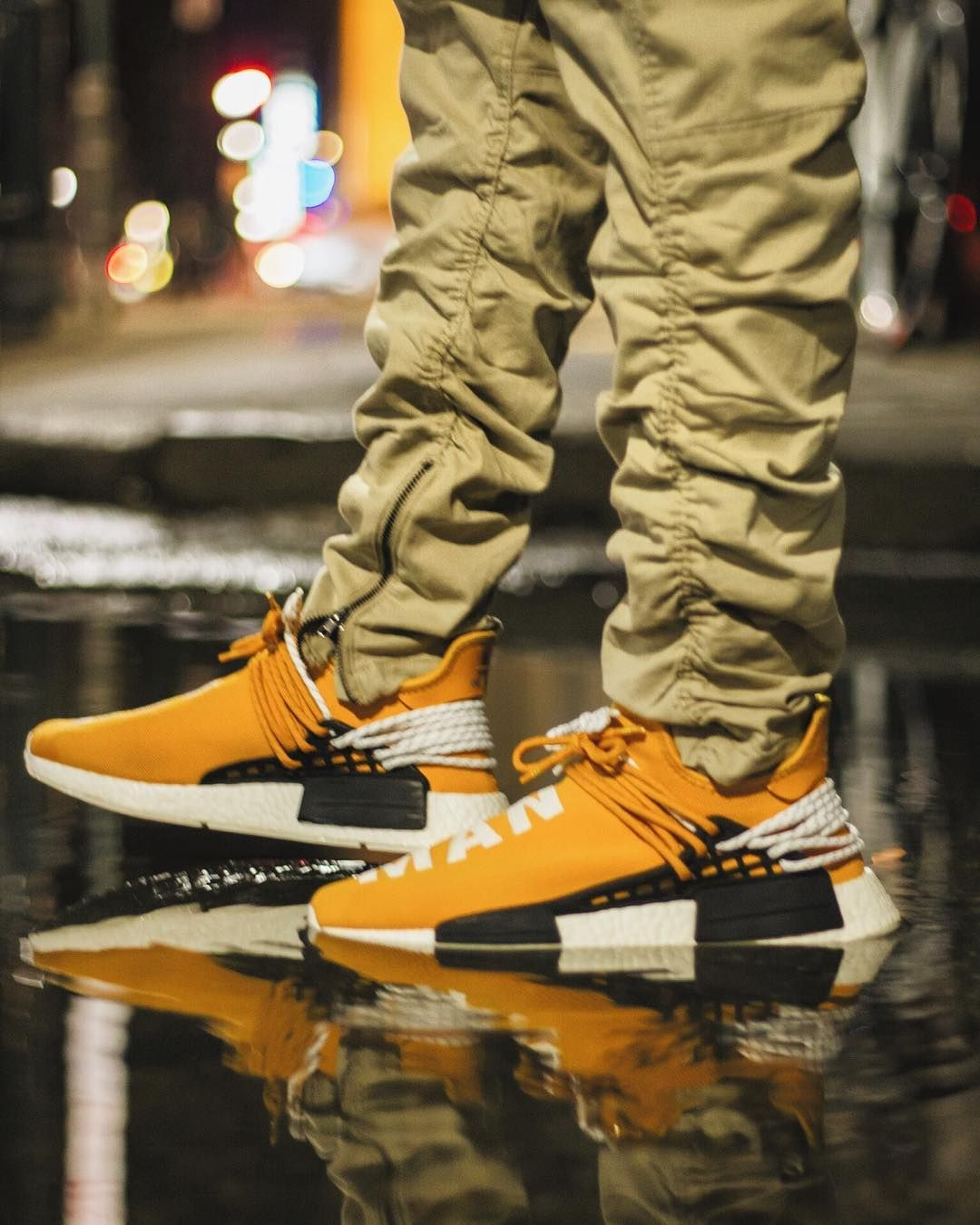 55867cf6f Pharrell Williams x adidas NMD Human Race Tangerine
