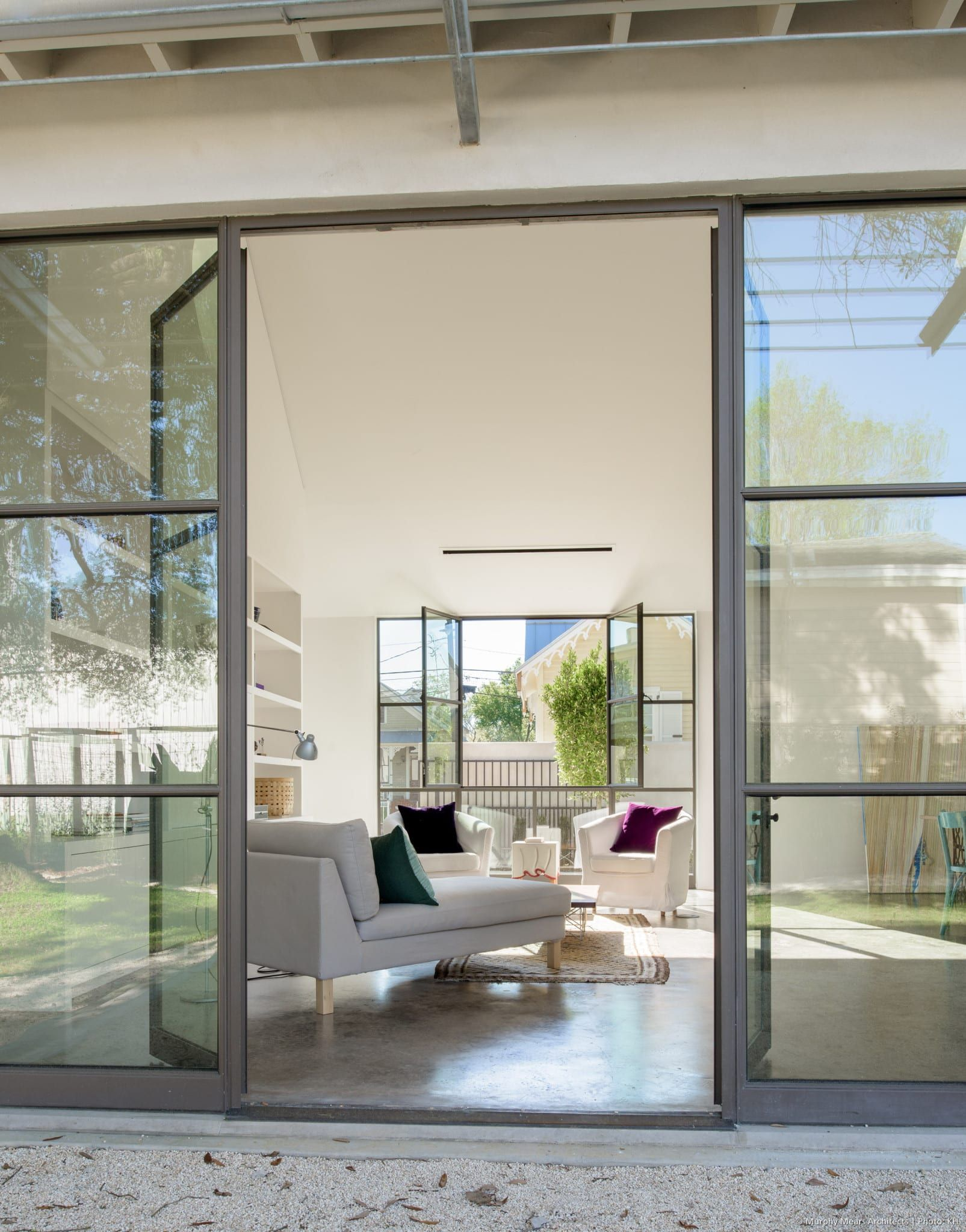 Doors and windows open to the front and back courtyards on each side ...