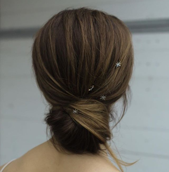 Low bun with star hair pins