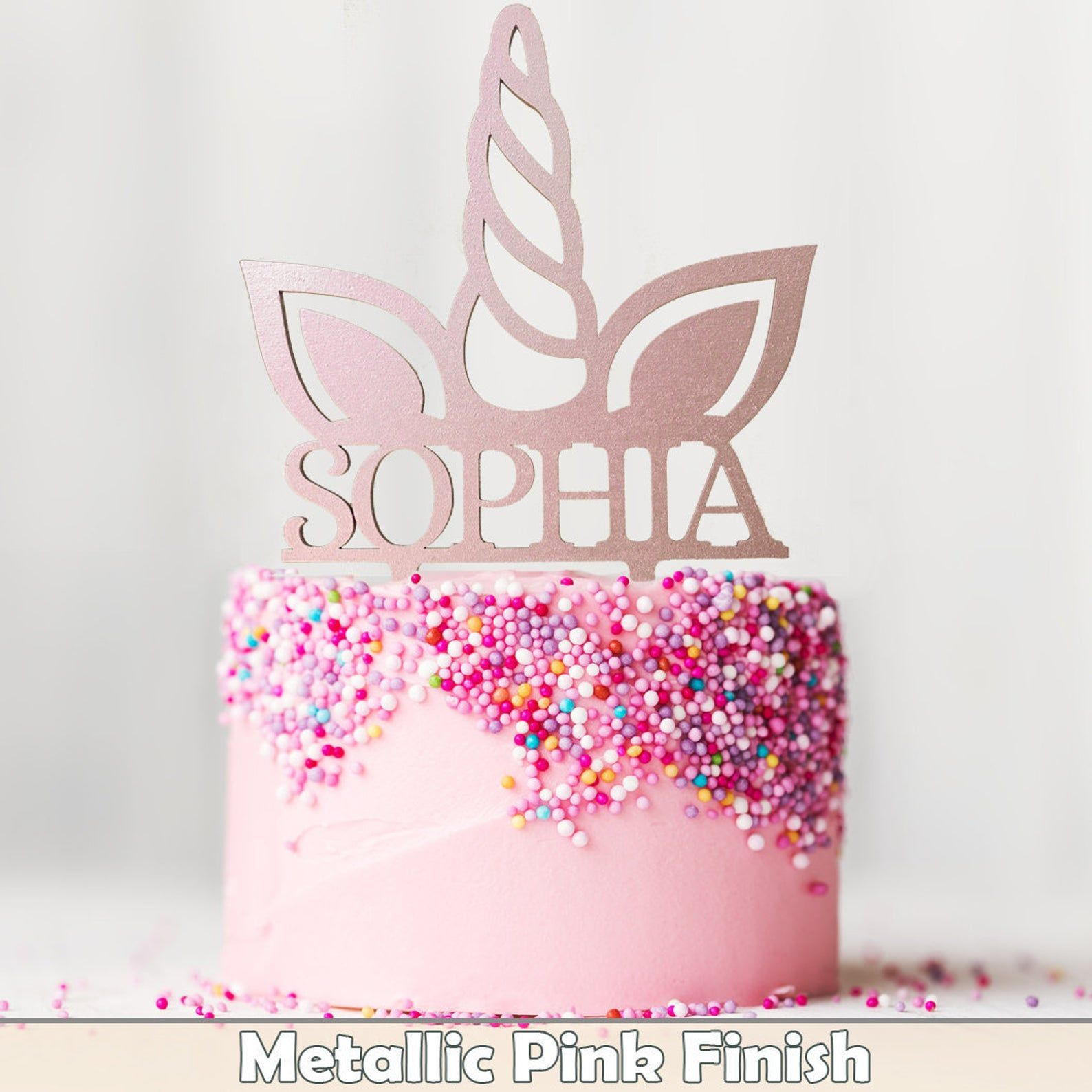 age or name clipped on Crown in glittery silver colored paper background Cake decoration