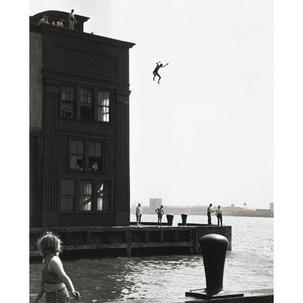 1948 gelatin silver print taken by Ruth Orkin named Boy Jumping into Hudson River