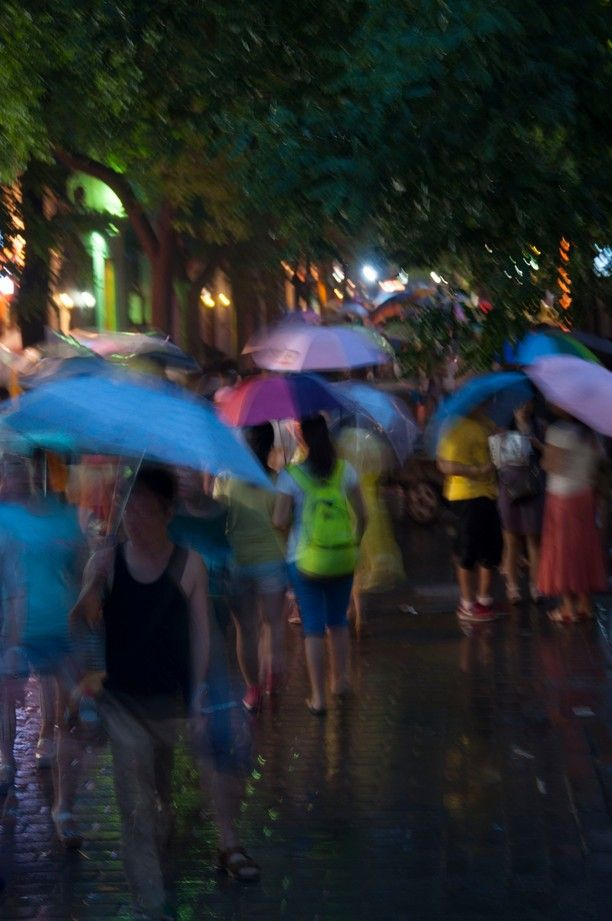 Beijing, China — by Neil Elrick. Busy CHinese hutong in the rain