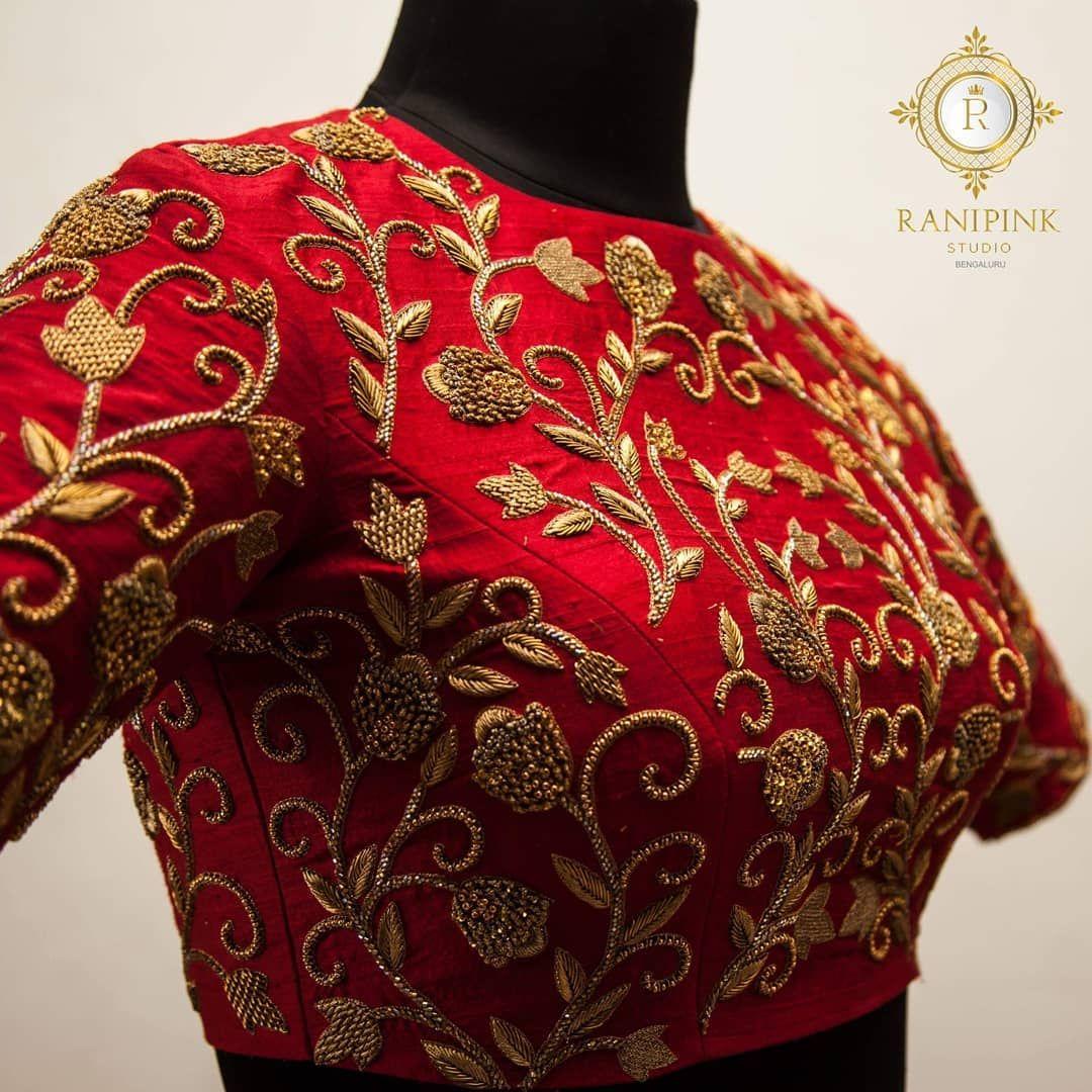 Stunning red color designer blouse with floral design hand