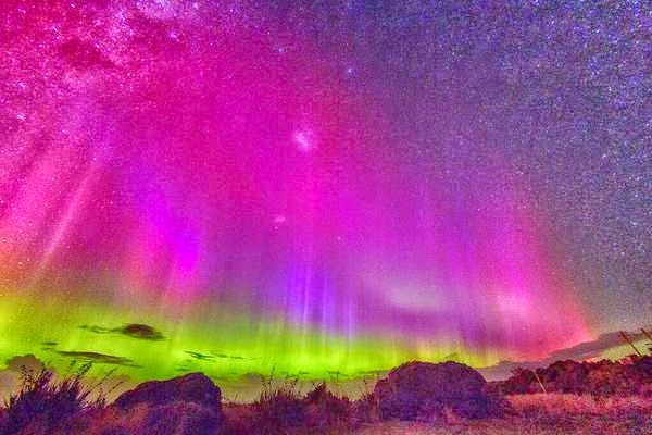 These lights are from Dunedin in New Zealand photographed by Ian Griffin (3/17/2015). This is Aorora Australis and only happens once every few years.It happens because of a solar storm which hits the earth with a jolt.