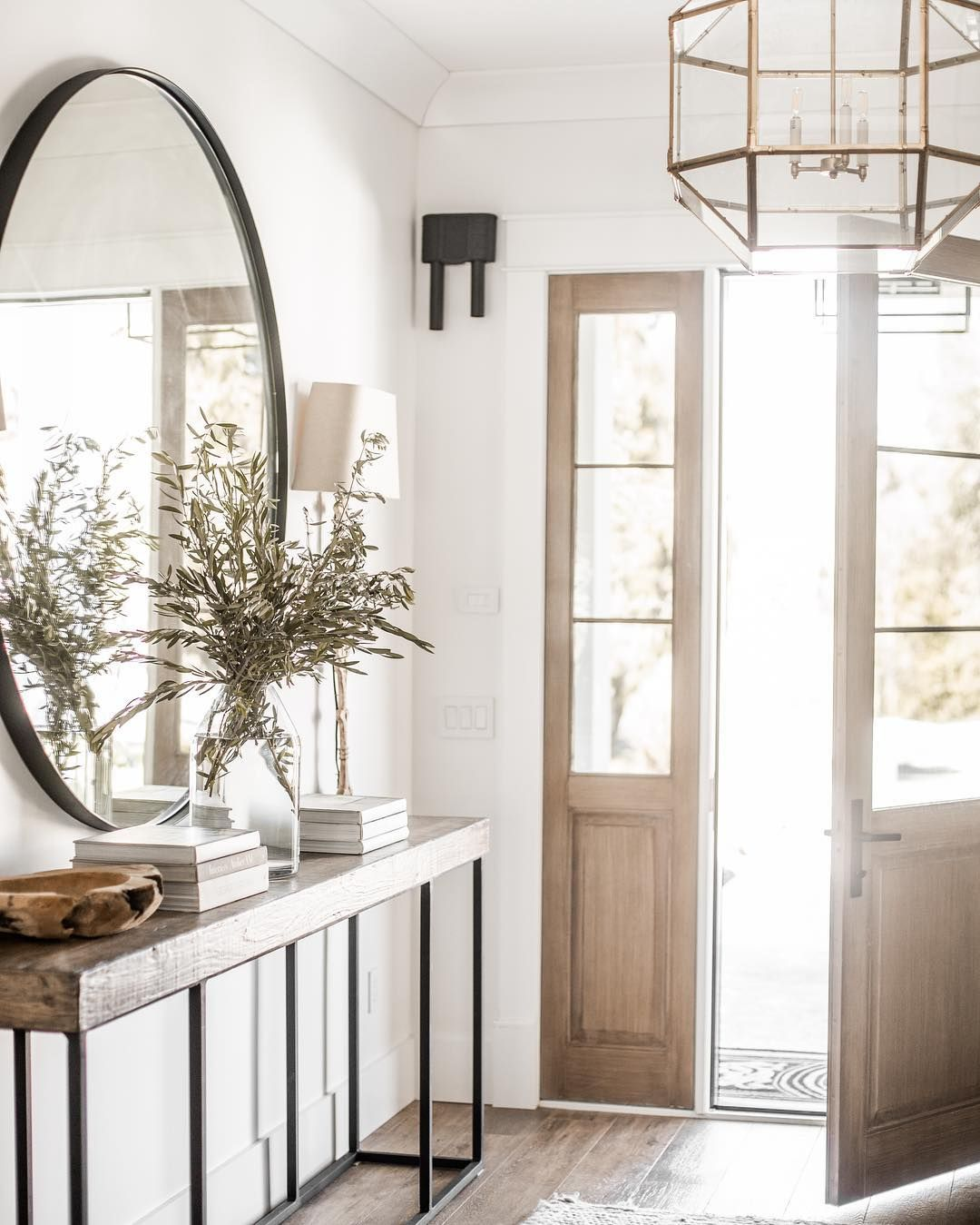 Farmhouse Entryway With Large Mirror Rustic Console Table And Glass Vase Of Olive Branches House Interior Entry Styling Interior