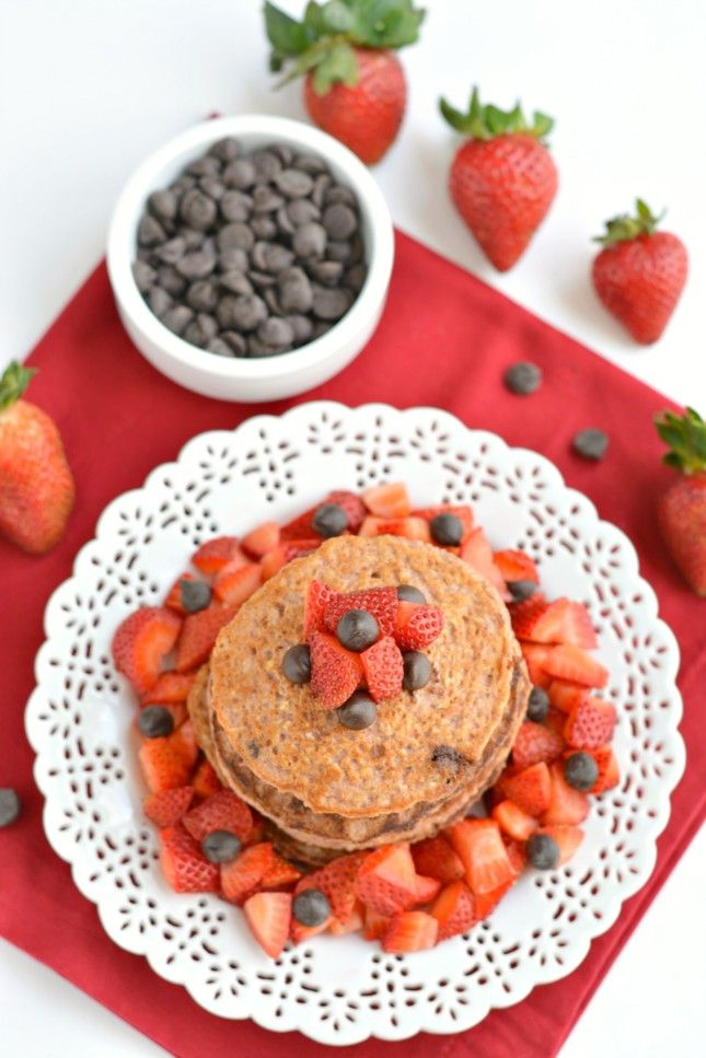 These Strawberry Oat Chocolate Chip Pancakes are made in the blender with creamy Greek yogurt, sweet strawberries and savory oats with chunks of dark chocolate nestled in the batter. Top with fresh berries for a perfectly sweet and healthy breakfast!