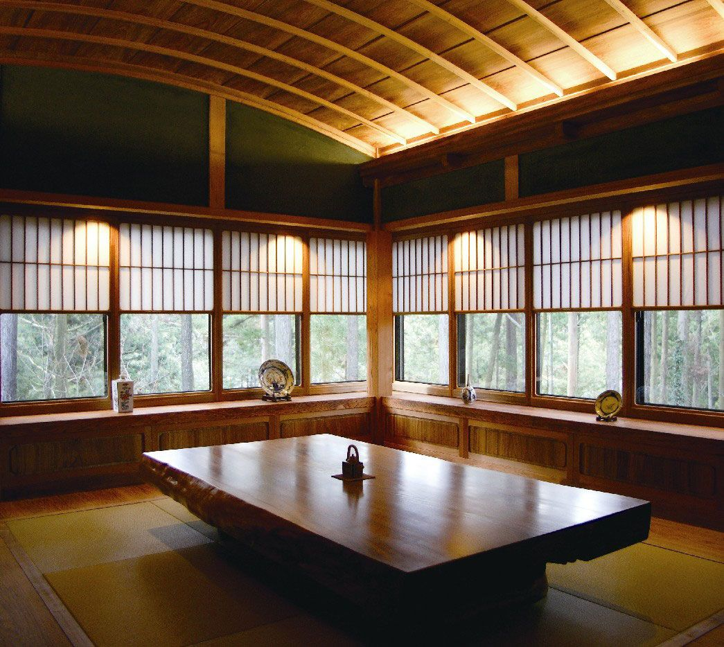 Setting Japanese Living Room Furniture With Many Glass Windows Surrounding  The Room And A Simple Traditional Table