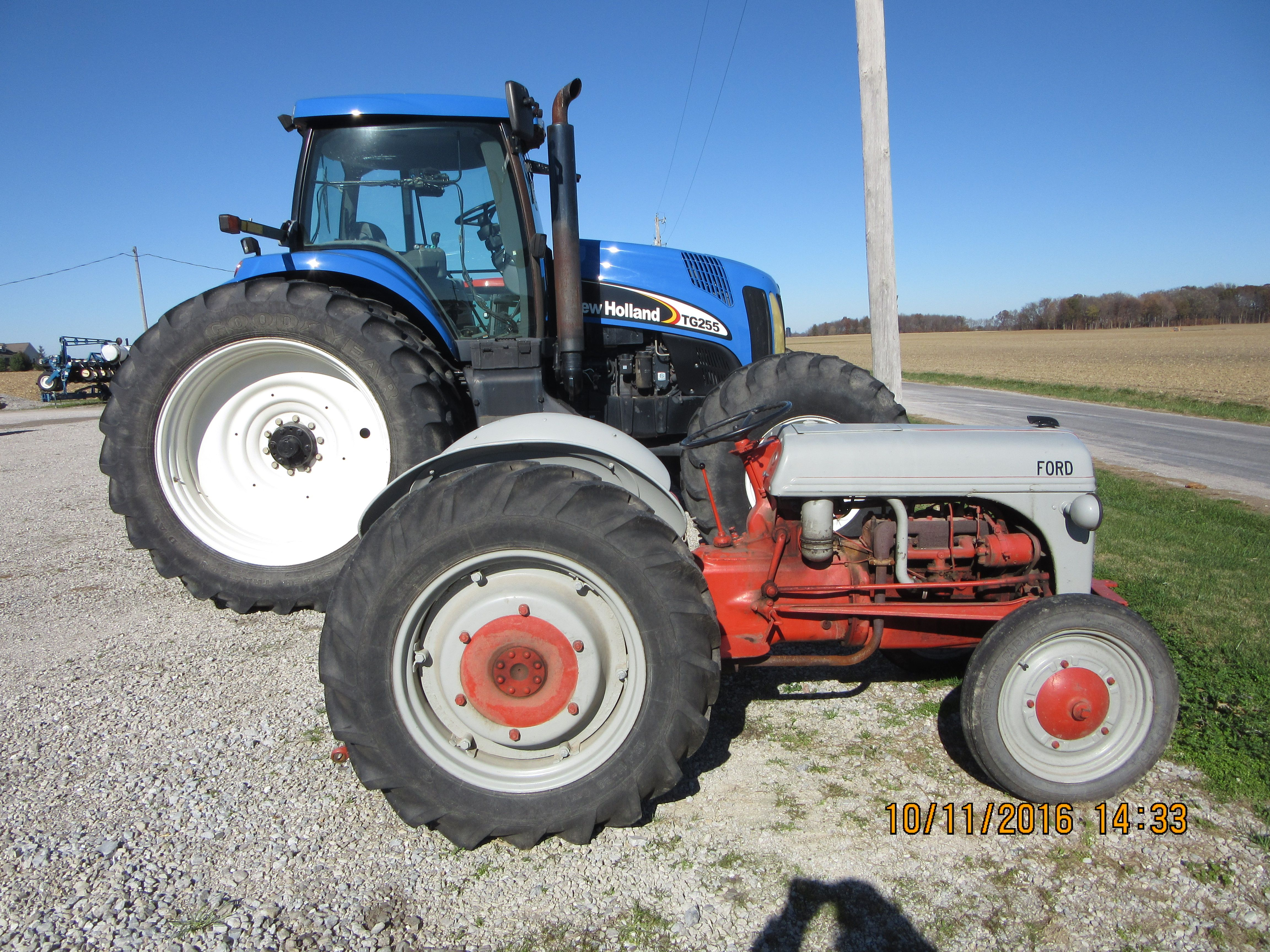 New Holland behind the Ford