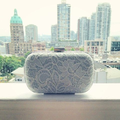 A Davie & Chiyo clutch! Plus 10% off your entire order when you enter WEDDINGCHICKS at checkout. http://www.davieandchiyo.com/collections/bridal-lace/products/antoinette-box-clutch-ivory-on-mint-more-colours