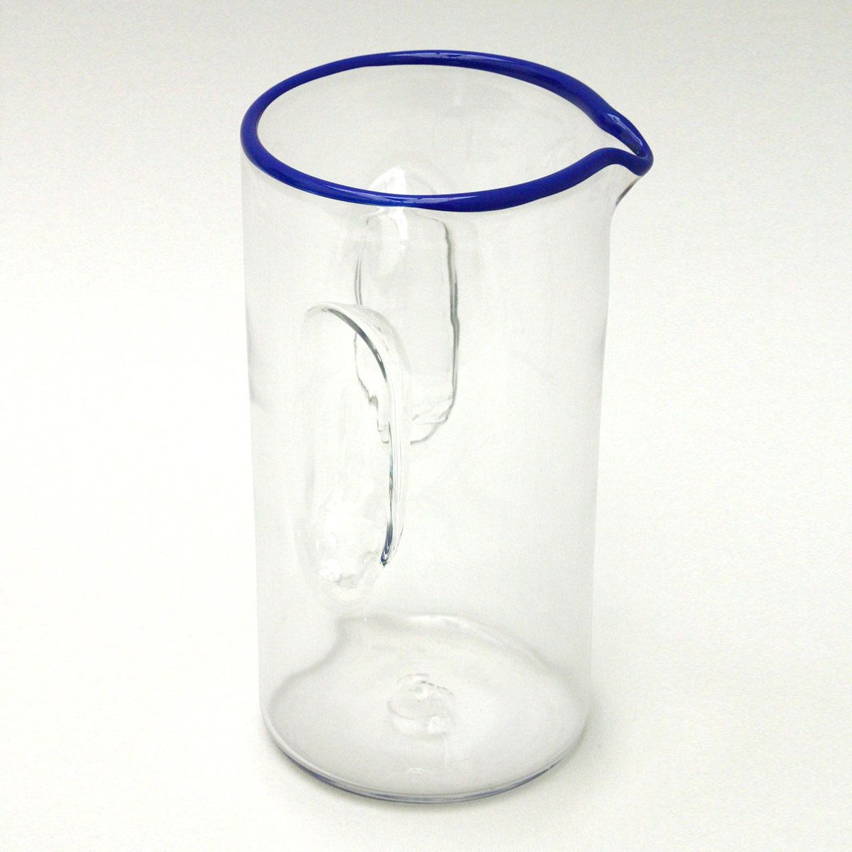 Indentations in the glass provide the grip in this pitcher.