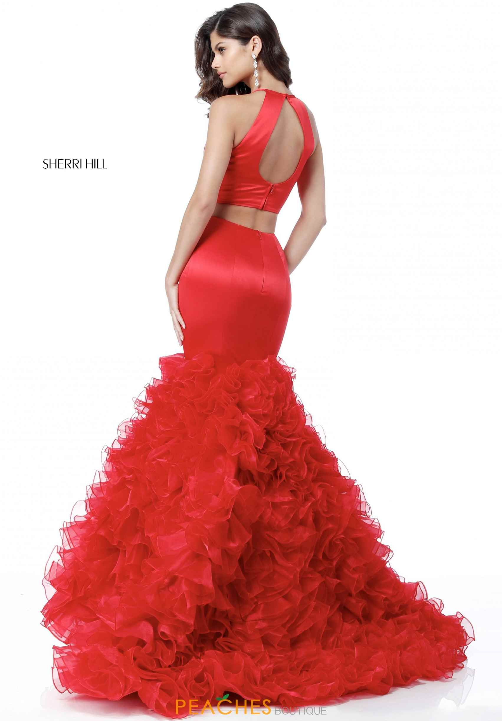 Check out this ravishing Sherri Hill 51801 dress for your prom. This dress  features a high halter neckline and a fitted satin crop top.
