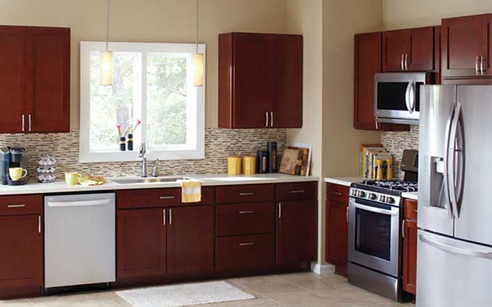 Low Cost Kitchen Cabinets A kitchen with cabinets in a new dark wood finish  Affordable