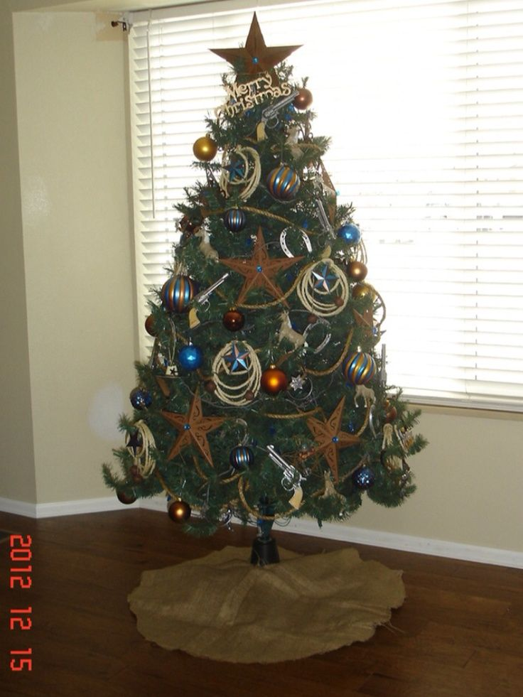 Western cowboy themed Christmas Tree. Love the copper and blue color  scheme. | Stylish Western Home Decorating - Western Cowboy Themed Christmas Tree. Love The Copper And Blue Color