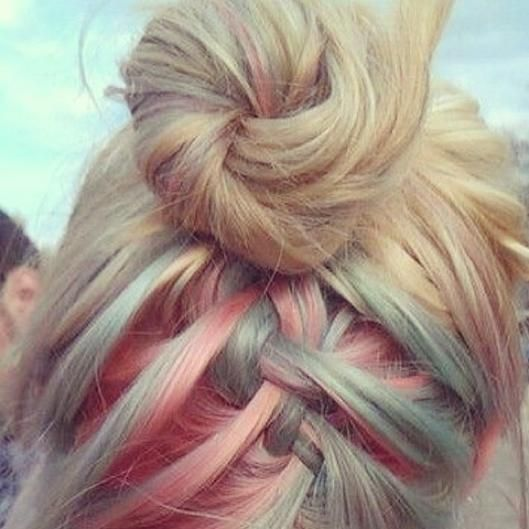 For a surprise burst of color, an upside down French braid into a bun makes for an unexpected hairstle in the back.