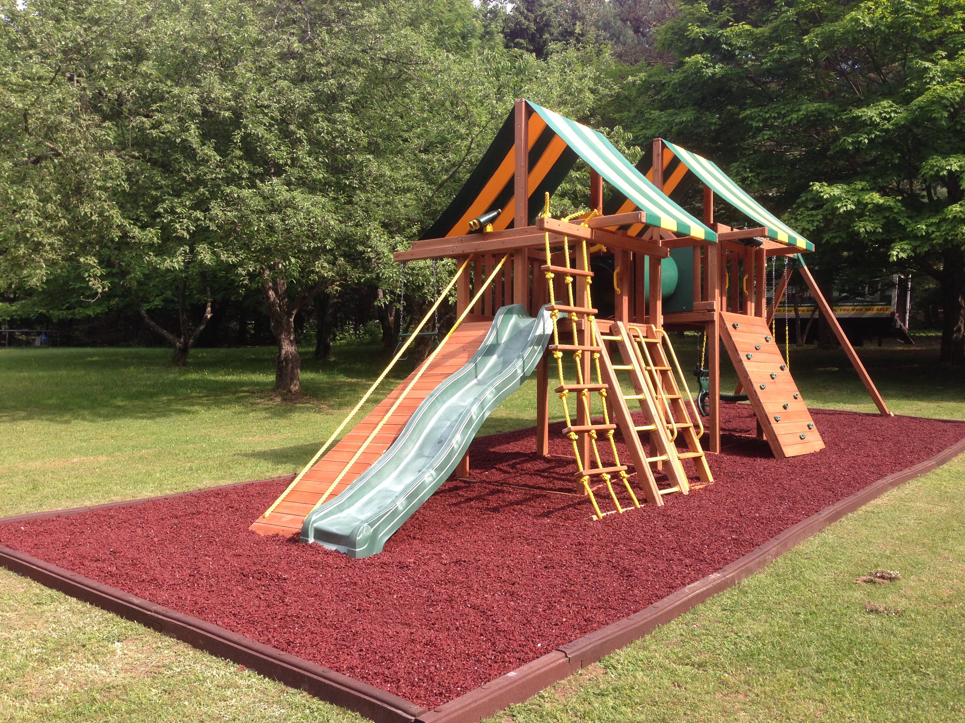 Custom swing set with red rubber mulch. | Playgrounds | Pinterest