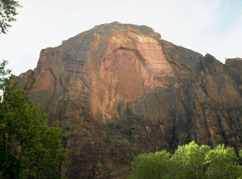 Massive canyon walls ascend toward a brilliant blue sky. To experience Zion, you need to walk among the towering cliffs, or challenge your courage in a small narrow canyon. These unique sandstone cliffs range in color from cream, to pink, to red.