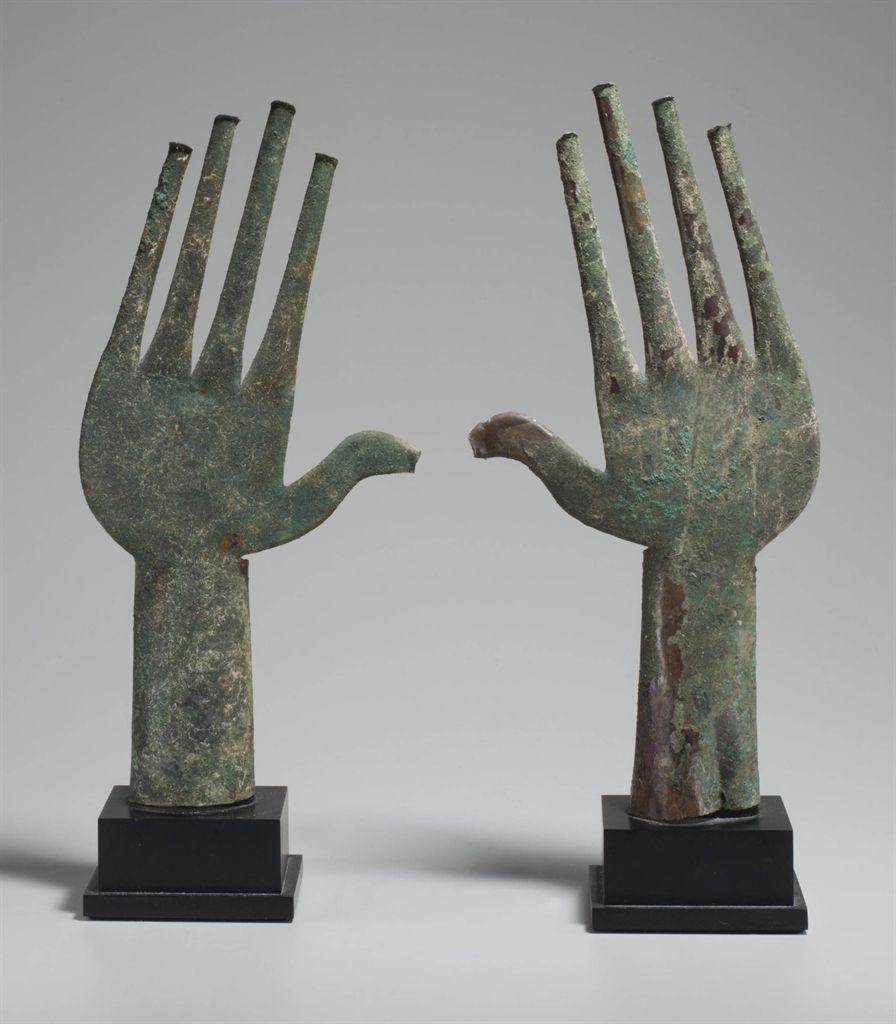 A PAIR OF VILLANOVAN BRONZE VOTIVE HANDS -  CIRCA 7TH CENTURY B.C.  | Christie's