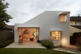 Image result for corrugated iron and white brick facade