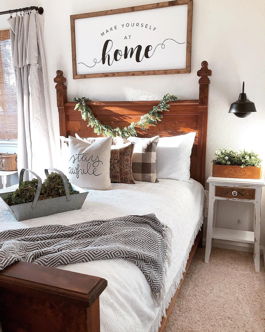 Farmhouse Guestroom Decor With Old Fashioned Wood Bed Grey Night Stand And Throw Sconce Lighting Make You Guest Bedroom Decor Remodel Bedroom Guest Bedrooms