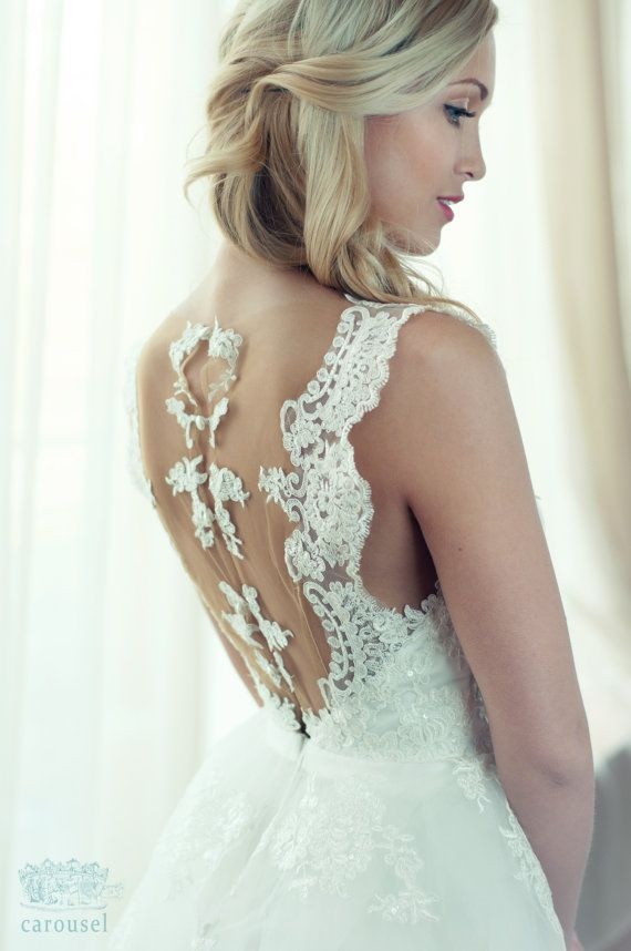 Gorgeous hand-embroidered wedding gown. A perfect fairytale dress. #CarouselFashion #WeddingStuff Blog at www.creativeweddingstuff.com