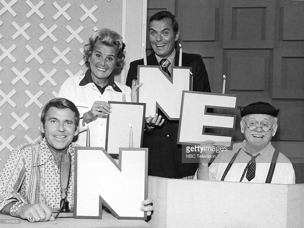 Promotional image of the celebrity panel and host from the television game show, 'Hollywood Squares' celebrating the beginning of the show's ninth season, 1974. From left to right: Paul Lynde, Rose Marie, host Peter Marshall and Charley Weaver.