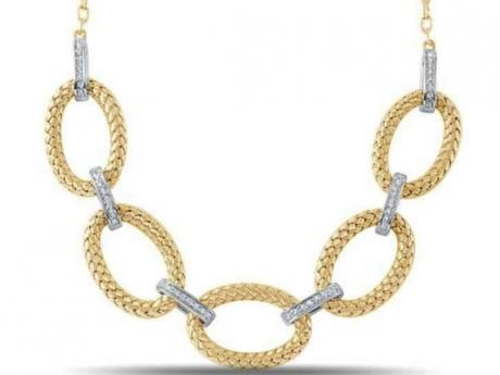 Sterling silver and yellow gold plated sterling silver Italian weaved oval link necklace with accenting cubic zirconia links.  Includes an attached st...