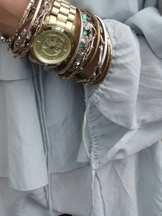 stacked bracelets and gold watch by
