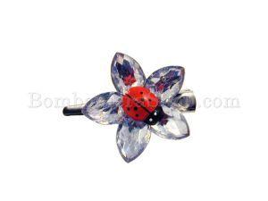 Fantastica molletta a fiore con una bellissima coccinella sopra, adatta per il fai da te..