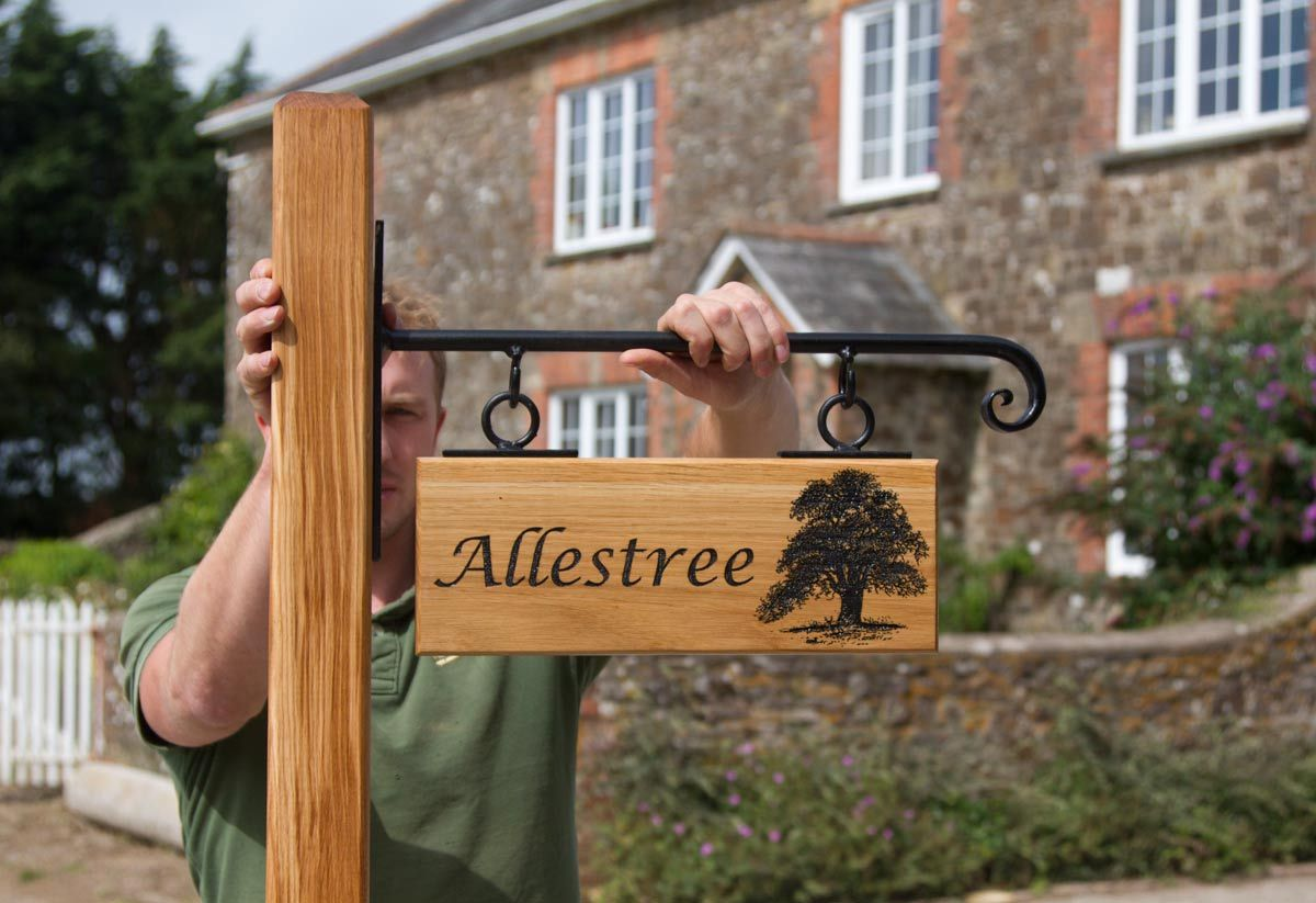 Hangin Oak Sign On Post With Wrought Iron Bracket Font Lucida Calligraphy Ref 1307 Lw 048 Www Sign Maker Net H Home Wooden Signs Metal House Signs Home Signs