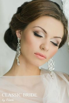 Stunning Wedding Hairstyle & Makeup. Beautiful and subtle eyes with peach lips. Love the sparkly earrings! | #clairetaylormua Have a special event coming up? Visit www.thebeautyspotqld.com.au for more info! .