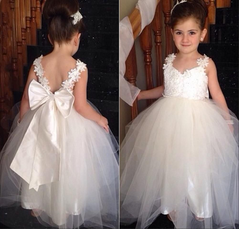 Delicate tulle lace appliques flower girl dress with bowknot 2015 lovely flower girls dresses with v neck two straps appliques tulle floor length white junior bridesmaid dress backless pageant dresses izmirmasajfo