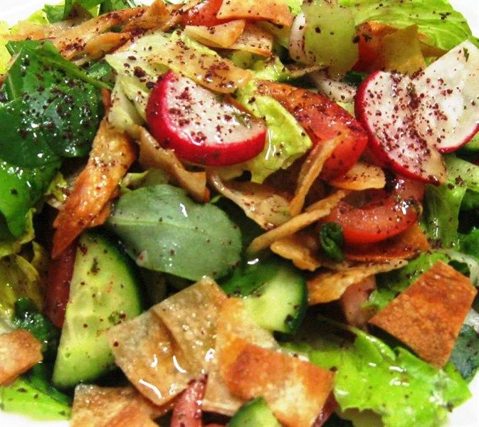"""Fattoush is one of the known traditional salads in the Middle Eastern cuisine. The main ingredients of this salad are """"Summa"""", which gives Fattoush its sour taste, and the fried or toasted Arabic bread pieces. It's a great salad at any time of the year, and it's well known to be served in Ramadan, Muslims fasting month."""