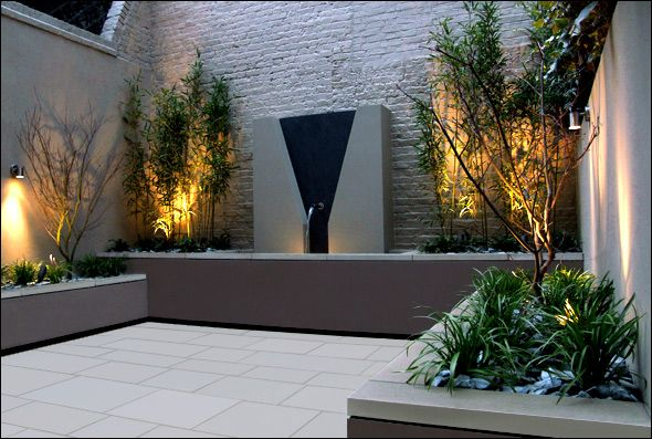 Garden Landscape Modern Courtyard With Wall Lighting And Painted Gray Brick Wall Also Beautiful Water Feature Awesome Roof Gardens And Lands Contemporary Garden Design Modern Courtyard Modern Garden Design