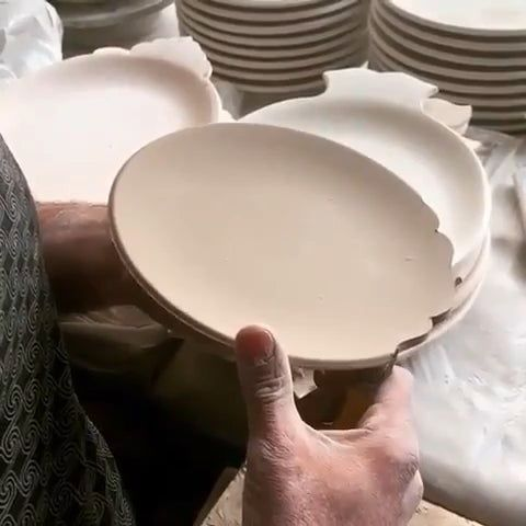 Hand trimming a clay plate. – the most current On More