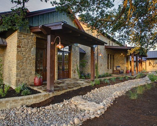 Hill Country Farmhouse - roof over front door | Cabin remodel ...