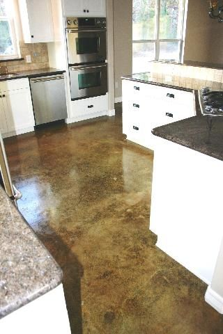 Stained concrete. Seriously thinking about busting up our wood ...