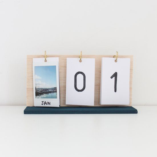 Make your own flip calendar using instax prints and some hooks