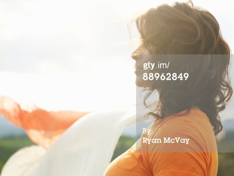 Royalty-free Image: Profile of mature woman at sunset