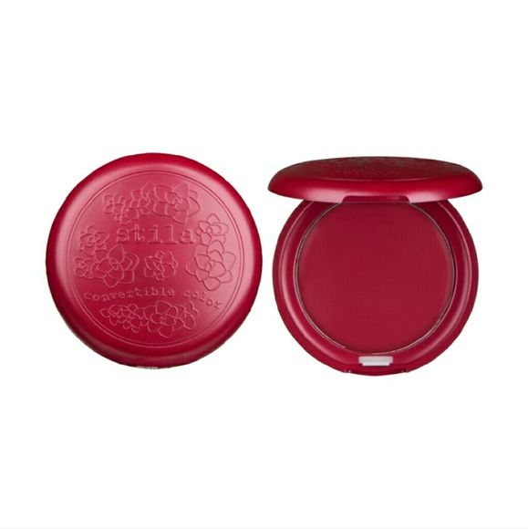 Stila Convertible Color Brand new,  no box. Stila Convertible Color in Tulip which is a sheer cherry red.  I love this product because you can use it on your cheeks or your lips and it looks great on both of them. This is also a nice shirt collar with a buildable formula so you can make it as dark as you like. These are great to keep in your purse for touch ups on the go! Stila Makeup Blush