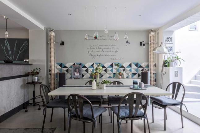 Estampados geomtricos y colores pastel para decorar un loft casa