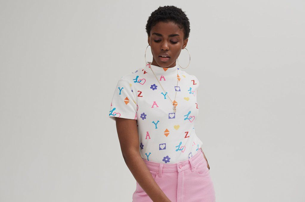 785947c1b718 Lazy Oaf House Of Logo Tee. Fitted short sleeve t-shirt. Soft-touch velour.  Cap sleeves. High neckline. Lazy Oaf printed back neck tape. All-over print.