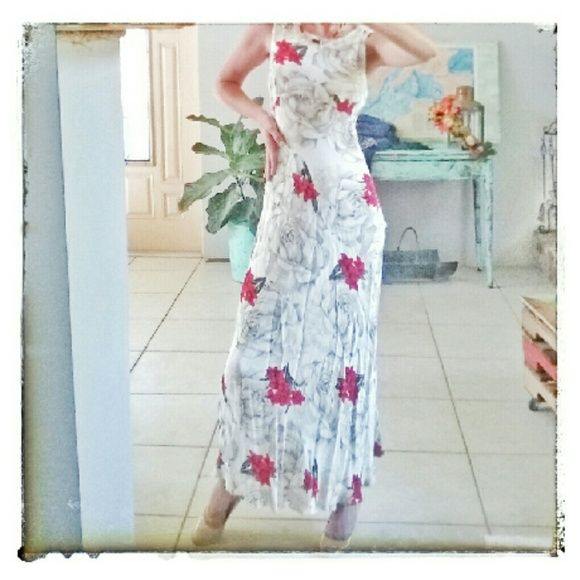 Vintage Nostalgia Sexy Floral Long Dress Vintage Nostalgia 100% Rayon to the floor dress. Size small, print is of grey faded roses with bright red Lily's on top of that. Quite a graphic and stand out print. Very sexy and slim. Has three materal coverd buttons on the back and a triangular cut out high up on the back holding it together with another materal coverd button. Dress has some faint stains, also pulls but it's not very noticeable due to print Nostalgia  Dresses Maxi